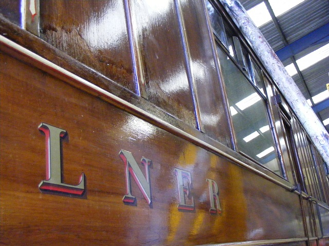 LNER buffer car 24278 receiving attention to its varnished teak body following water damage.