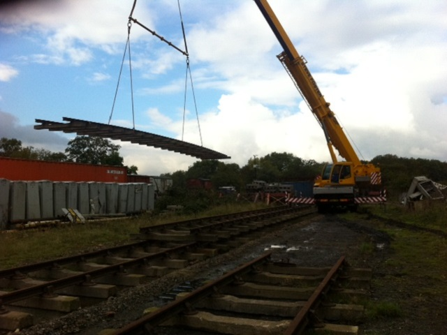 Site clearance at Swithland Sidings continues in preparation for the construction of the shed foundations. Clearance work has required a crane to come in to handle some of the larger items that need to be moved before work can start.