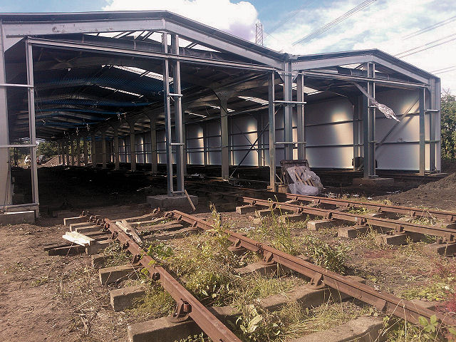 9th July. If you look closely you will see that the side walls are now in place along with the roof, the roller doors are installed, trackwork is in place for roads 2 and 4. A start has been made on the wall at the rear of the shed.